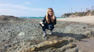 Collecting sea glass at Laguna Beach, California