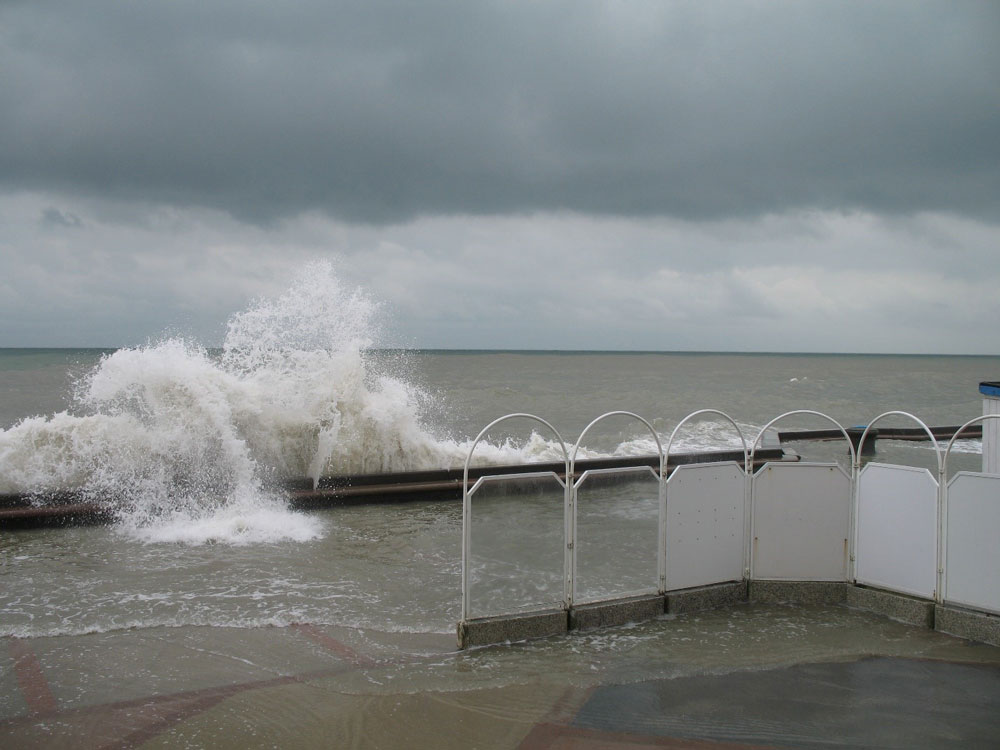Large waves breaking over a sea wall.