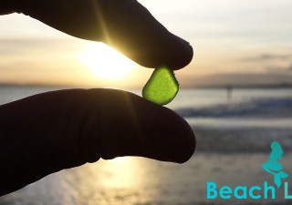 Green sea glass at sunset, found on Southbourne Beach, Bournemouth