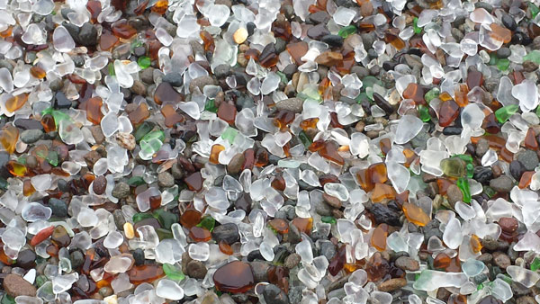 Close up of green, olive, amber, brown and clear or white sea glass at Glass Beach.