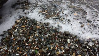 Pacific ocean washing sea glass onto Glass Beach, Fort Bragg