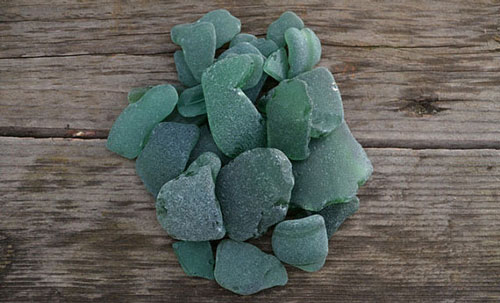 Pieces of forest green sea glass