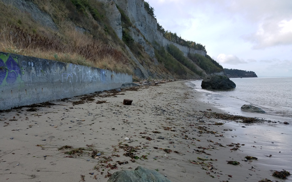 The graffiti wall at North Beach, Port Townsend heading towards McCurdy Point and Glass Beach.