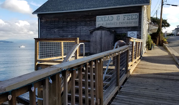 Historic Coupeville boardwalk and public wooden deck with beach access stairs on Whidbey Island, Washington.