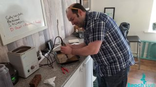 Gavin Hardy drilling sea glass at his Seaham Waves jewelry studio