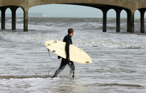 Surfer at Boscombe Pier