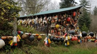 House covered in marine buoys near Forks, Washington