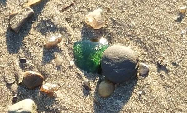 Image of green sea glass found on the beach at Lands End Beach on Bailey Island.