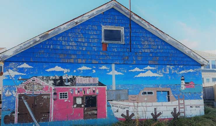 Image of painted boat house in Maine.